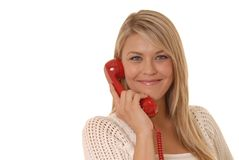 Lovely Girl on Telephone. Lovely girl on standard telephone Royalty Free Stock Photography