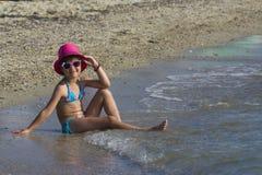 Lovely girl on tropical beach Stock Photo