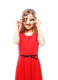 Lovely girl wearing a red mask. Stock Photography