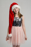 Lovely girl wearing red Santa hat Royalty Free Stock Images