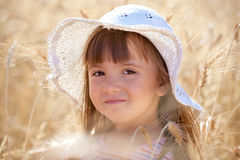 Lovely girl among wheat ears Stock Images