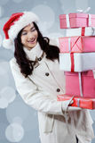 Lovely girl in winter coat get christmas gift boxes Stock Photos
