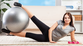 Lovely girl working out at home Royalty Free Stock Photos