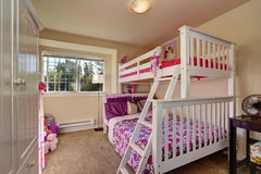 Lovely girls bedroom with bunk bed and carpet floor. Royalty Free Stock Image
