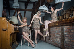 Lovely girls dressed in flapper style outfits royalty free stock photo