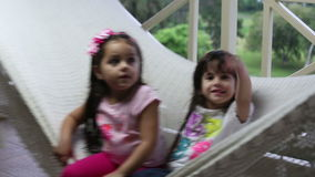 Lovely girls playing in hammock. stock footage