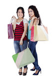 Lovely girls with shopping bags Royalty Free Stock Photography