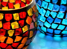 Glass. Mosaic candleholders in warm and cold color tones Royalty Free Stock Image