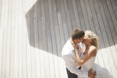 Lovely, gorgeous couple kissing close to pool area after wedding Royalty Free Stock Photo