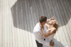 Lovely, gorgeous couple kissing close to pool area after wedding Royalty Free Stock Photography