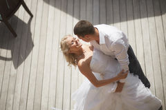 Lovely, gorgeous couple kissing close to pool area after wedding Stock Photo