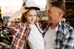 Lovely gorgeous girl trying on fathers cap Stock Photo