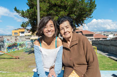 Lovely grandmother and granddaughter sitting Stock Images