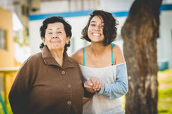 Lovely grandmother and granddaughter standing Stock Images