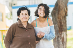 Lovely grandmother and granddaughter standing Royalty Free Stock Photo