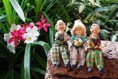 Lovely grandparents with child ceramic dolls Royalty Free Stock Photos