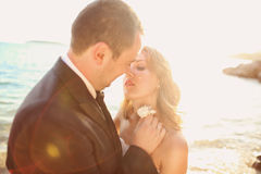 Lovely Groom and bride outdoors on a sunny day Royalty Free Stock Photos