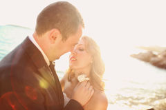 Lovely Groom and bride outdoors on a sunny day Stock Images