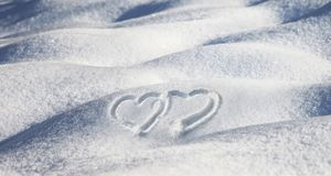 Lovely hand drawn two heart shapes in snow Royalty Free Stock Image