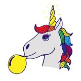 Lovely hand-drawn unicorn the inflating sphere from chewing gum. Lovely hand-drawn unicorn the inflating sphere from yellow chewing gum Royalty Free Stock Images