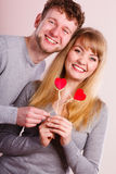 Lovely happy couple with hearts. Royalty Free Stock Photo