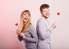 Lovely happy couple with hearts. Stock Images