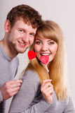 Lovely happy couple with hearts. Stock Photos