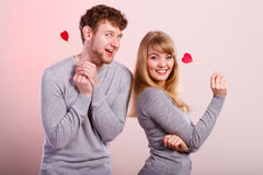 Lovely happy couple with hearts. Stock Image