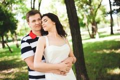 Lovely happy couple at summer park, sunny day stock photo