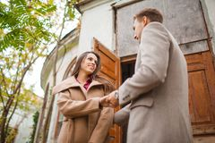Lovely happy couple walking on the street together. Royalty Free Stock Images