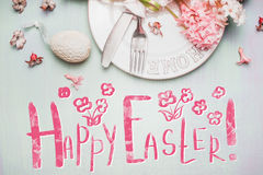 Lovely Happy Easter greeting card with text, eggs, cakes and spring hyacinths flowers in pastel Royalty Free Stock Photo