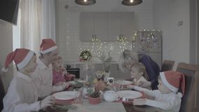 Lovely happy excited family of six celebrating Christmas dinner in festive atmosphere cozy kitchen. Happy lovely excited family of six celebrating Christmas stock video