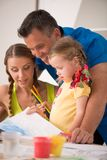 Lovely happy family drawing and painting at home Royalty Free Stock Images