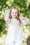 Lovely happy little princess girl with water Royalty Free Stock Images