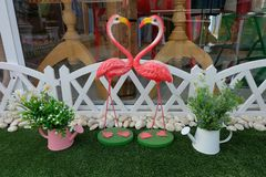 Lovely heart by couple swans in mini mock garden. Stock Images