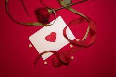 Lovely heart envelope with pearls and a rose royalty free stock images