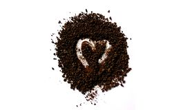 Lovely heart in pile of instant coffee. With white background Royalty Free Stock Image