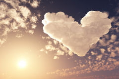 Lovely heart in sunset sky Stock Photos