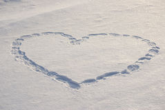Lovely Heart on White Snow Stock Image