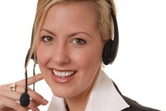 Lovely Help Desk Lady 3. Beautiful and sexy blond business woman with headset Royalty Free Stock Photos