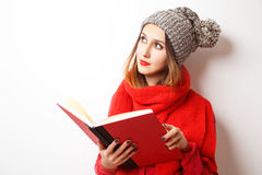 Lovely Hipster Girl in Winter Clothes with Book Stock Images