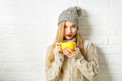 Lovely Hipster Woman in Winter Clothes with Cup Royalty Free Stock Image