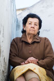 Lovely hispanic grandmother wearing yellow skirt Royalty Free Stock Images