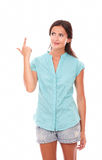 Lovely hispanic woman in blue blouse pointing up Royalty Free Stock Photography
