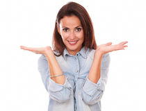 Lovely hispanic woman holding her palms up Royalty Free Stock Image