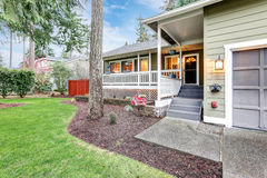 Lovely home exterior with welcoming covered porch Stock Photos