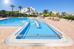 Lovely  hotel swimming pool in the summer outside. Royalty Free Stock Photo