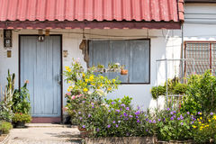 Lovely house front with closed window and flowers, little maisonette and cottage Royalty Free Stock Photos