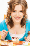 Lovely housewife with cake and candle Royalty Free Stock Images