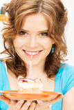 Lovely housewife with cake and candle Royalty Free Stock Photo